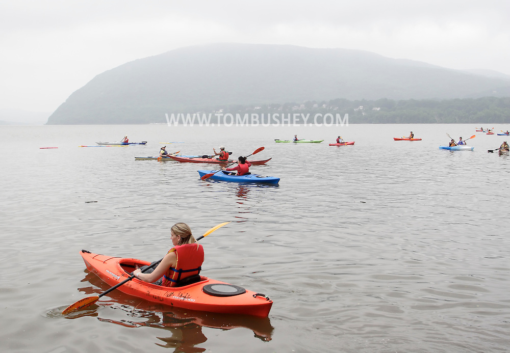 New Windsor, New York - Kayakers take to the Hudson River at the Paddlefest event sponsored by the Mid-Hudson Chapter of the Adirondack Mountain Club at Kowawese Unique Area at Plum Point on  Sunday, June 13, 2010.