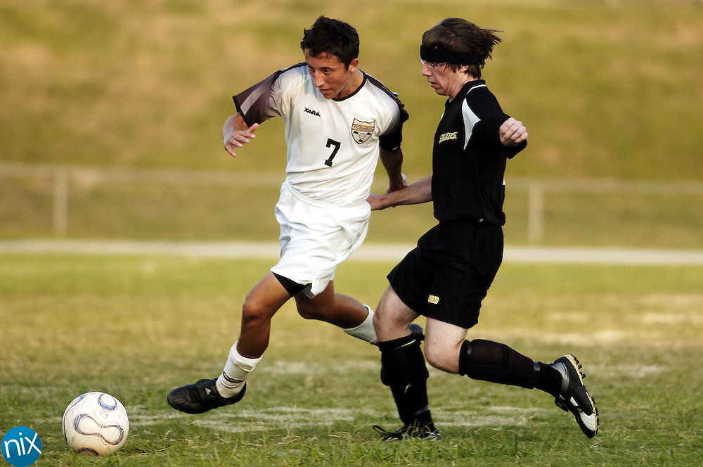 J M Robinson's Tony Nunes dribbles past Concord's Steven Kinane Tuesday night.