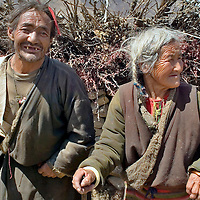 Two old Tibetan who are affected by the Kashin-Beck Disease, are using a cane to walk. One of the characteristics of this disease is that it affects the normal growth of the bones and disables the person to walk normally..Narme, Tibet, China. April 14, 2007. Photo: Bernardo De Niz