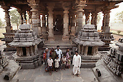 An Indian family visiting the temple at Halebid, South India. The ancient capital of the Hoysalas, Halebid was then known as Dwarasamudram. The great city of Dwarasamudra flourished as a Capital of the Hoysala Empire during the 12th & 13th centuries.