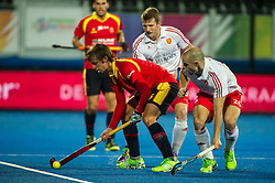 Spain's Bosco Perez Pla is watched by Nick Catlin and Sam Ward of England. England v Spain - Unibet EuroHockey Championships, Lee Valley Hockey & Tennis Centre, London, UK on 25 August 2015. Photo: Simon Parker