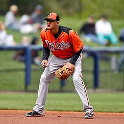Mar 2, 2013; Port Charlotte, FL, USA; Baltimore Orioles third baseman Manny Machado (13) in the field during the bottom of the first inning of a spring training game against the Tampa Bay Rays at Charlotte Sports Park. Mandatory Credit: Derick E. Hingle-USA TODAY Sports