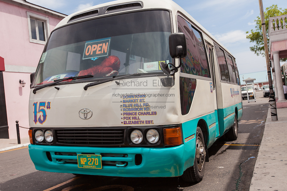 A jitney bus waits for passengers in downtown Nassau, Bahamas.