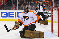 Jan 21; Newark, NJ, USA; Philadelphia Flyers goalie Ilya Bryzgalov (30) makes a pad save during the first period of their game against the New Jersey Devils at the Prudential Center.