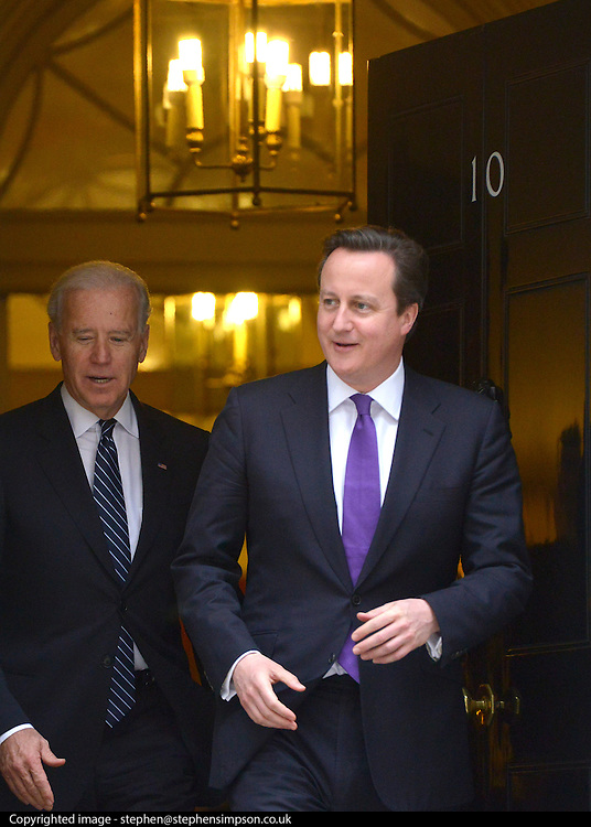 © Licensed to London News Pictures. 05/02/2013. Westminster, UK American Vice President Joe Biden (L) leaves number 10 Downing Street with British Prime Minister David Cameron after meetings today 5th February 2013. Photo credit : Stephen Simpson/LNP