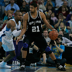 29 March 2009: San Antonio Spurs center Tim Duncan (21) is guarded by New Orleans Hornets forward David West (30) during a 90-86 victory by the New Orleans Hornets over Southwestern Division rivals the San Antonio Spurs at the New Orleans Arena in New Orleans, Louisiana.