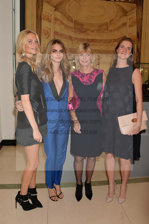 Left to right, POPPY DELEVINGNE, CARA DELEVINGNE, PANDORA DELEVINGNE and CHLOE GRANT at a Dinner to celebrate the launch of the Mulberry Cara Delevingne Collection held at Claridge's, Brook Street, London on 16th February 2014.