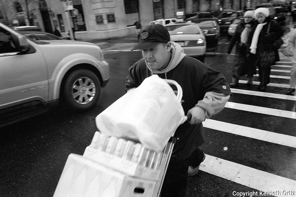 Delivery guy making his rounds crossing 5th Avenue.