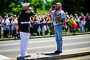 "For the 11th consecutive year, former United States Marine Tim Chambers holds a salute to honor fallen veterans as hundreds of thousands of motorcycle riders participate in Rolling Thunder's annual Memorial Day weekend ""Ride To The Wall"", converging on the Vietnam Veterans Memorial in Washington, DC, USA on 26 May, 2013. Rolling Thunder Inc. is a non-profit organization dedicated to the search of American soldiers who are prisoners of war or missing in action. Rolling Thunder was established in 1987."