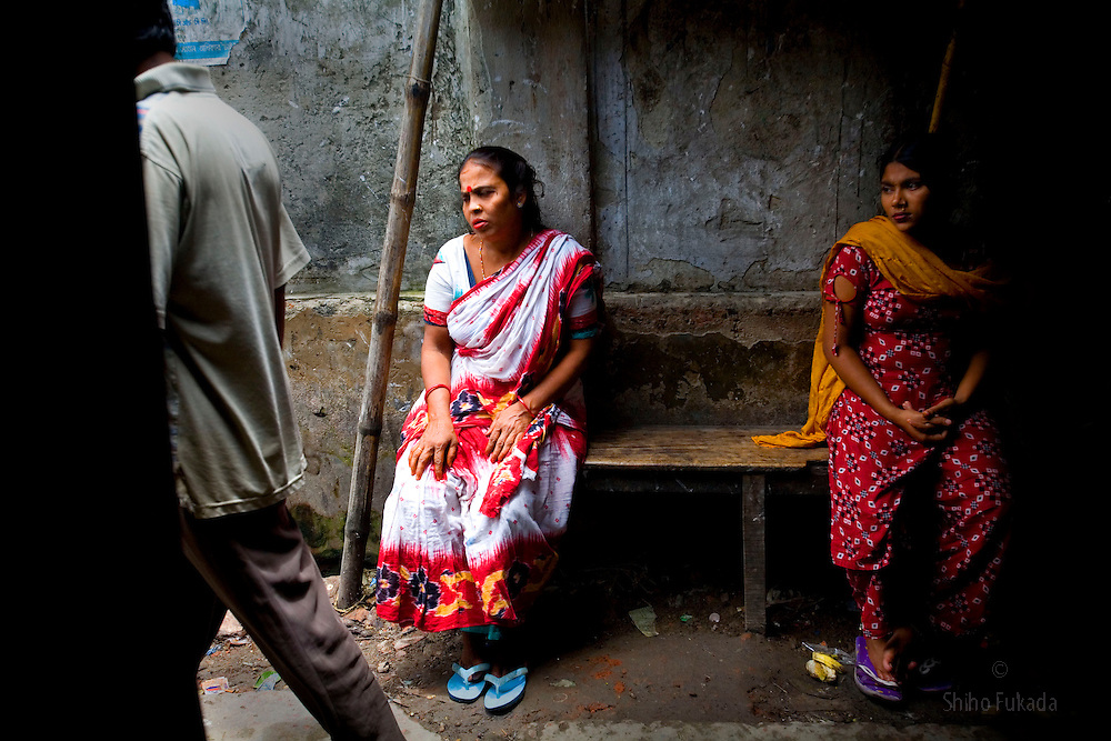Aging sex worker Josna, 60, waits for a cutomer at brothel in Faridpur, Bangladesh.