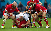 Leicester, Great Britain, Jamie CUDMORE tackled by Mihaita LAZAR,  left Hooker Ray BARKWELL and right, Hubert BUYDENS, during the Pool D game, Canada vs Romania.  2015 Rugby World Cup,  Venue, Leicester City Stadium, ENGLAND.  Tuesday    06/10/2015.   [Mandatory Credit; Peter Spurrier/Intersport-images]