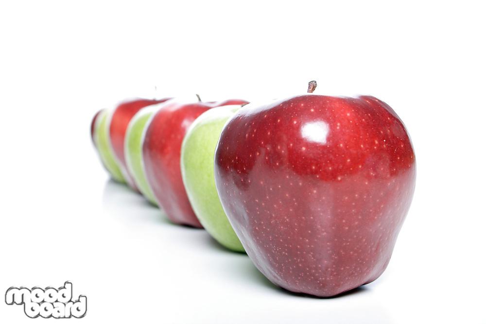 Studio shot of apples in row