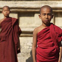 Young novice monks pose in the Bagan region of Myanmar.