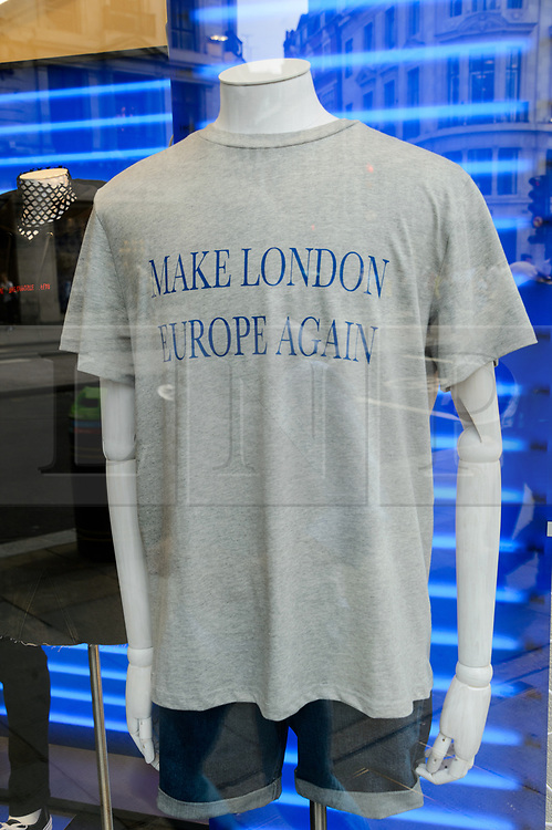 "© Licensed to London News Pictures. 18/08/2017. London, UK. t-shirt with the printed message ""Make London Europe Again"".  A different printed message will be on sale every week at the opening of H&M group's first Weekday clothing store in Regent Street. Weekday is know for its offerings and minimalist styles, with 27 stores throughout Europe. The store is next to the H&M Arket lifestyle store. Photo credit: Ray Tang/LNP"