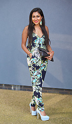 LIVERPOOL, ENGLAND - Thursday, April 9, 2015: Shahana Bhaskaran, 20, from London wearing a jump suit from River Island and shoes from New Look during Grand Opening Day on Day One of the Aintree Grand National Festival at Aintree Racecourse. (Pic by David Rawcliffe/Propaganda)