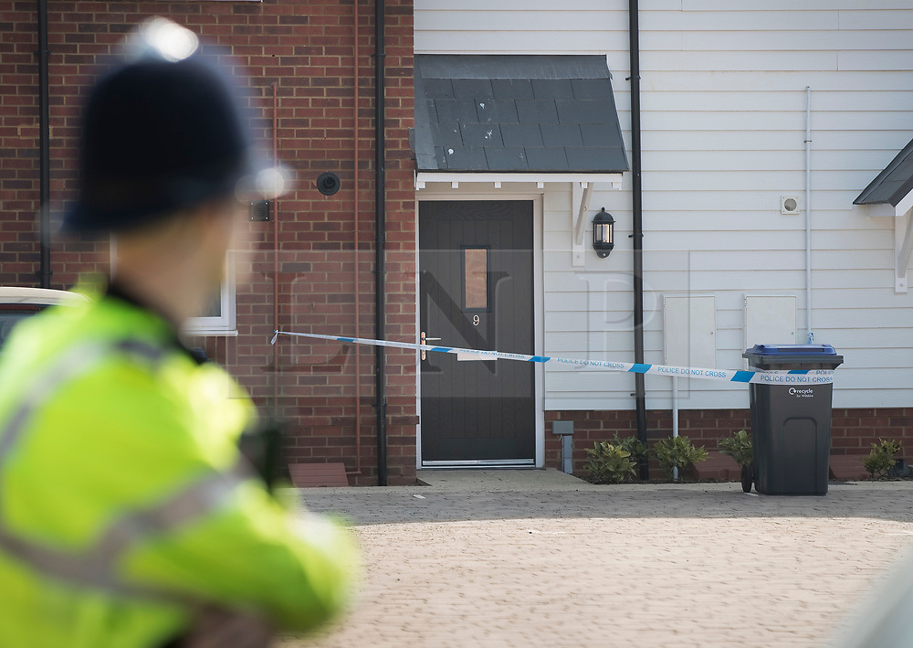 © Licensed to London News Pictures. 04/07/2018. Amesbury, UK. A police officer stands outside a property in Muggleton Road, Amesbury after a couple named locally as Dawn Sturgess, 44, and her partner Charlie Rowley, 45, were taken ill on Saturday 30th June 2018. Police have confirmed that the couple have been in contact with Novichok nerve agent. Former Russian spy Sergei Skripal and his daughter Yulia were poisoned with Novichok nerve agent in nearby Salisbury in March 2018.Photo credit: Peter Macdiarmid/LNP