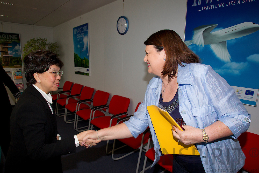 From left Dr. Margaret Chan, Director-General for WHO, greeting Maire Geoghegan-Quinn, EU-Commissioner for Research in connection with the World Health Organization and European Commission Summit in Brussels Friday 25 March 2011. PHOTO: ERIK LUNTANG / INSPIRIT Photo.
