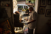 Medellin, Colombia- March 15, 2015: A cook prepares chicharrón, a traditional paisa dish, at La Gloria de Gloria. In addition to the delicious dishes, expect owner Doña Gloria to offer you a shot of aguardiente, a strong anise-flavored liquor, while you wait. CREDIT: Chris Carmichael for The New York Times