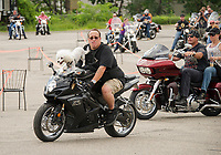 """Russ Holliday with """"Opie"""" riding shotgun heads out for the 13th annual Brenda's Ride with Friends from Faro Italian Grille Saturday morning.  Proceeds to benefit the LRGHealthcare Oncology Department.  (Karen Bobotas/for the Laconia Daily Sun)"""
