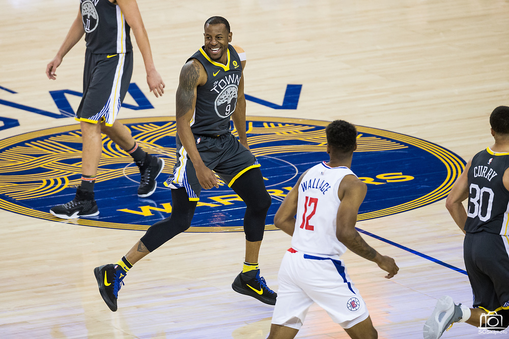 Golden State Warriors forward Andre Iguodala (9) celebrates a dunk against the LA Clippers at Oracle Arena in Oakland, California, on February 22, 2018. (Stan Olszewski/Special to S.F. Examiner)