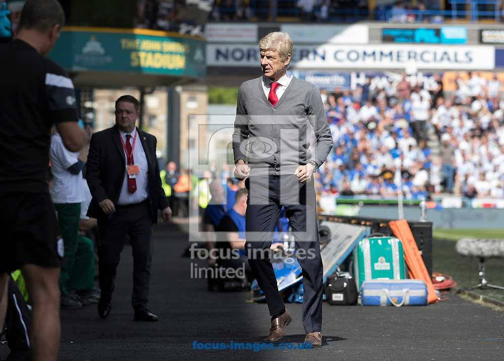 Arsene Wenger of Arsenal leaves his dugout to walk down the tunnel at half time during the Premier League match at the John Smiths Stadium, Huddersfield<br /> Picture by James Wilson/Focus Images Ltd 07522 978714‬‬<br /> 13/05/2018