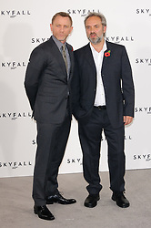 Daniel Craig and Sam Mendes  pose for photographers at the photocall for the 23rd James Bond movie 'Skyfall', London, Thursday November 3, 2011. Photo By i-Images