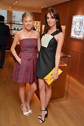 Left to right, ROSIE WHITCOMBE and LADY VIOLET MANNERS at a party to celebrate the launch of Le Jardin de Monsieur Li by Hermes in association with Mr Fogg's was held at Hermes, 155 New Bond Street, London on 9th July 2015.