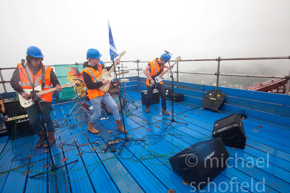 Bwani Junction, the Edinburgh based band, made music history by becoming the first group to playing on the Forth Rail Bridge, they played on the highest point of the 122-year-old structure..©Michael Schofield.