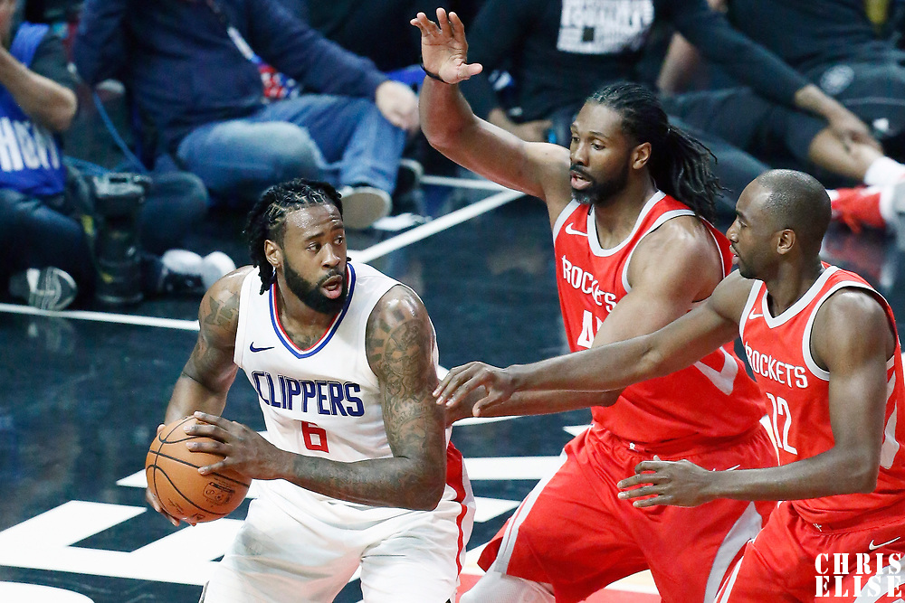 28 February 2018: Houston Rockets center Nene Hilario (42) and Houston Rockets forward Luc Mbah a Moute (12) defend on LA Clippers center DeAndre Jordan (6) during the Houston Rockets 105-92 victory over the LA Clippers, at the Staples Center, Los Angeles, California, USA.