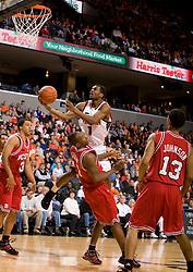 Virginia guard Jeff Jones (1) is fouled while shooting by North Carolina State forward Gavin Grant (11).  The Virginia Cavaliers men's basketball team defeated the North Carolina State Wolfpack 78-60 at the John Paul Jones Arena in Charlottesville, VA on February 24, 2008.