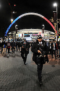 Armed Police walk through the crowd before the Breast Cancer Care International Friendly match between England and France at Wembley Stadium, London<br /> Picture by Richard Blaxall/Focus Images Ltd +44 7853 364624<br /> 17/11/2015