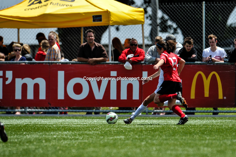 Action in front of sponsor signs in the ASB Womens League Final, Mainland Pride v NZF Development, 7 December 2014. Photo:John Davidson/www.photosport.co.nz