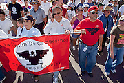 Apr. 19, 2009 -- PHOENIX, AZ: ARTURO S. RODRIGUEZ, president of the United Farm Workers of America, gives an interview on his cell phone while leading a march through central Phoenix. About 2,000 people marched from the Arizona State Capitol to Cesar Chavez Plaza in downtown Phoenix. The march was organized by the United Farm Workers of America to promote immigration reform.  Photo by Jack Kurtz