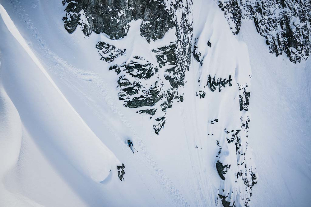 """Don't be late for supper."" Simon Thomson makes quick work of a couloir on Lakehead Peak, Howson Range, British Columbia."