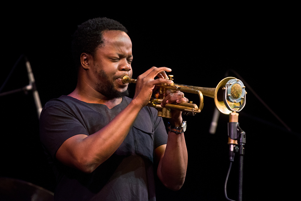"mkb072717c/metro/072717 -- Ambrose Akinmusire, a jazz trumpeter,  performs a free youth concert before his show at the South Broadway Cultural Center in Albuquerque, Thursday, July 27, 2017.  ""Just get up there and just play. Just express yourself,"" said Akinmusire about the advice that he was told as a young trumpet player. Akinsusire's Thursday performance was part of the 12th Annual New Mexico Jazz Festival. The festival continues through August 5.  (Marla Brose/Albuquerque Journal)"