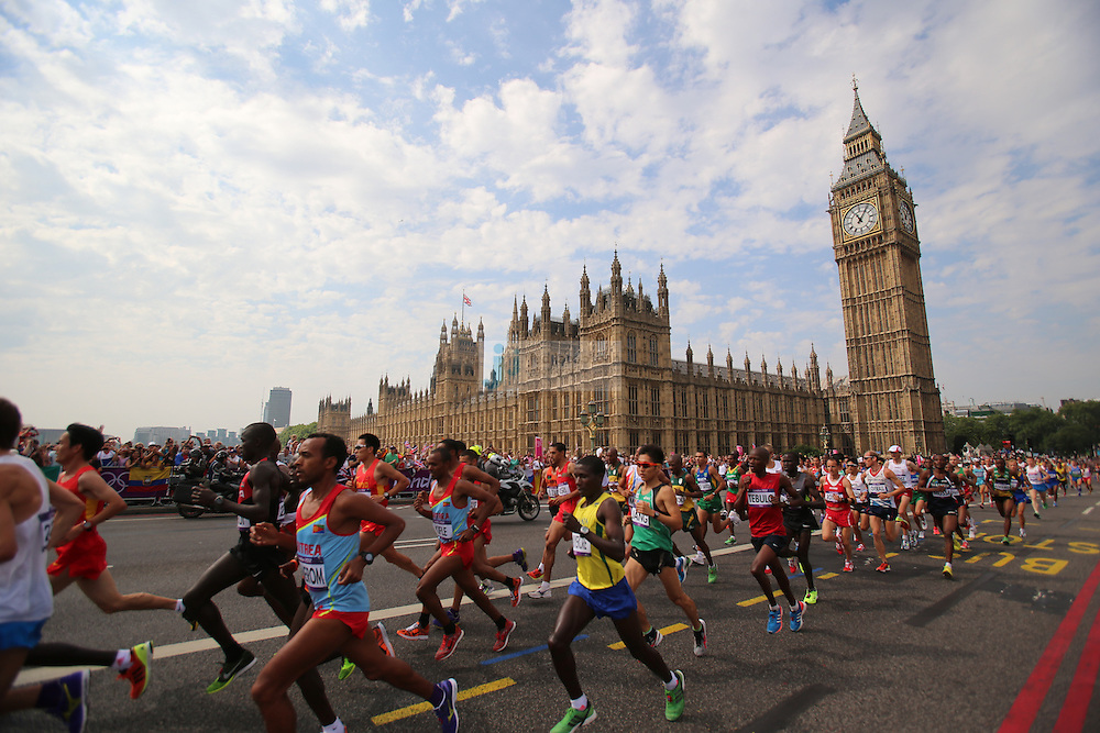 Runners pass Big Ben during the men's marathon during day 16 of the London Olympic Games in London, England, United Kingdom on August 12, 2012..(Jed Jacobsohn/for The New York Times)..