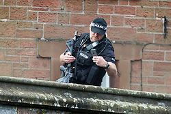© Licensed to London News Pictures. 09/06/2017. Appleby UK. Armed Police mingle with visitors to the Appleby horse fair that is taking place in the village of Appleby, the annual event dates back to the 18th century & see's travellers wash their horses in the River Eden. Photo credit: Andrew McCaren/LNP