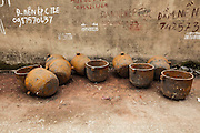 Empty molds used in a  foundry of Man Xa village lay on the ground, Vietnam, Southeast Asia