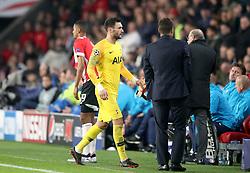 Tottenham Hotspur goalkeeper Hugo Lloris leaves the pitch after being sent-off