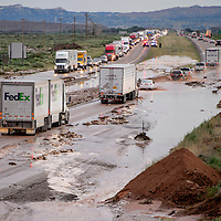 070315       Cable Hoover<br /> <br /> Eastbound and westbound traffic on Interstate Highway 40 is reduced to two lanes as police divert drivers around flooding near the Wingate Friday.