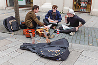 Buskers have a meal break in Cornmarket, Belfast, N Ireland, UK. August 2017, 2017081293746<br />