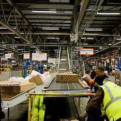 20100218 - LIEGE, BELGIUM - Employees from TNT Express Worldwide S.A. process incoming and outgoing freight February , 2009, at the Liège Airport in Grâce-Hollogne, Belgium. Approximately 90,000 packages move through TNT's main European hub every night. ( Photo © Patrick Mascart / Scorpix )