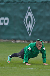 28.03.2014, Trainingsgelaende, Bremen, GER, 1. FBL, Werder Bremen, Training, im Bild Aaron Hunt (Bremen #14) macht Liegestuetze, im Hintergrund die Werder-Raute // Aaron Hunt (Bremen #14) macht Liegestuetze, im Hintergrund die Werder-Raute during a Trainingssession of German Bundesliga Club SV Werder Bremen at the Trainingsgelaende in Bremen, Germany on 2014/03/28. EXPA Pictures © 2014, PhotoCredit: EXPA/ Andreas Gumz<br /> <br /> *****ATTENTION - OUT of GER*****