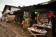 Nairobi, June 2010 - street front with in the shop and normal muddy road in Kibera slum