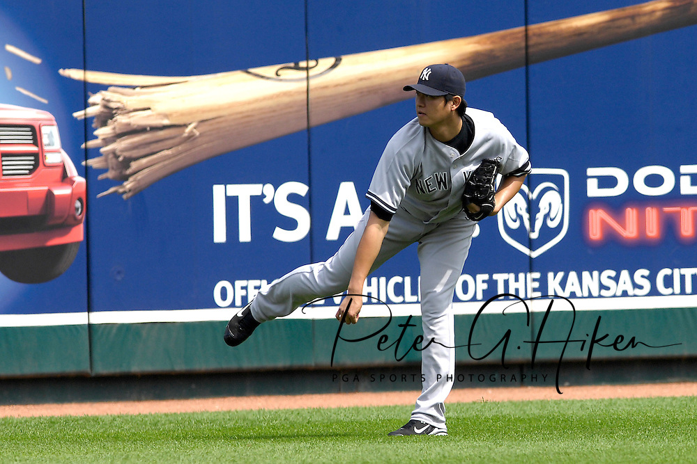 September 9, 2007 - Kansas City, MO..New York Yankees pitcher Chien-Ming Wang plays long toss before a game against the Kansas City Royals at Kauffman Stadium in Kansas City, Missouri on September 9, 2007....Photo by Peter G. Aiken/Cal Sport Media