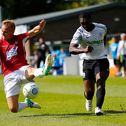 AUGUST 12:  Dover Athletic against Wrexham in Conference Premier at Crabble Stadium in Dover, England. Dover's defender Femi Ilesanmi squeezes a cross pass Wrexham's midfielder Marcus Kelly. (Photo by Matt Bristow/mattbristow.net)