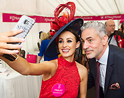 Repro Free. Sinead de Buitleir  from Kilkenny with Baz Ashmawy guest judge  at the g Hotel Best Dressed competitions at the Galway Races. Photo: Andrew Downes, xposure