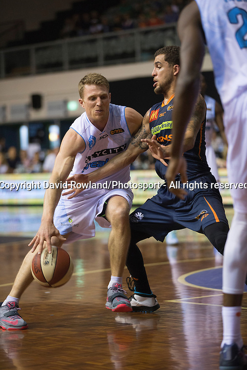 Breakers` Rhys Carter is challenged by Taipans` Scott Wilbekin in the SkyCity Breakers v Cairns Taipans, 2014/15 ANBL Basketball Season, North Shore Events Centre, Auckland, New Zealand, Thursday, October 23, 2014. Photo: David Rowland/Photosport