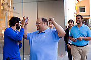 14 OCTOBER 2011 - SCOTTSDALE, AZ:   Shoppers hoping to buy an iPhone 4S file into the Apple Store in the Scottsdale Quarter just after the store opened. Hundreds of people lined up at the Apple Store in the Scottsdale Quarter in Scottsdale, AZ, Friday, Oct. 14, to buy the iPhone 4S. The phone sold out in pre-orders last week and sales at the Scottsdale Apple Store were brisk through the morning.     PHOTO BY JACK KURTZ