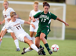 Virginia Cavaliers midfielder/forward Sinead Farrelly (17) slide tackles the ball away from Loyola Greyhounds midfielder Kelly Farrell (17).  The #6 Virginia Cavaliers defeated the Loyola College Greyhounds 4-0 in a NCAA Women's Soccer game held at Klockner Stadium on the Grounds of the University of Virginia in Charlottesville, VA on August 22, 2008.